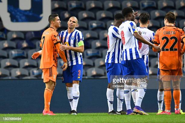 Cristiano Ronaldo of Juventus interacts with Pepe of FC Porto following the UEFA Champions League Round of 16 match between FC Porto and Juventus at...