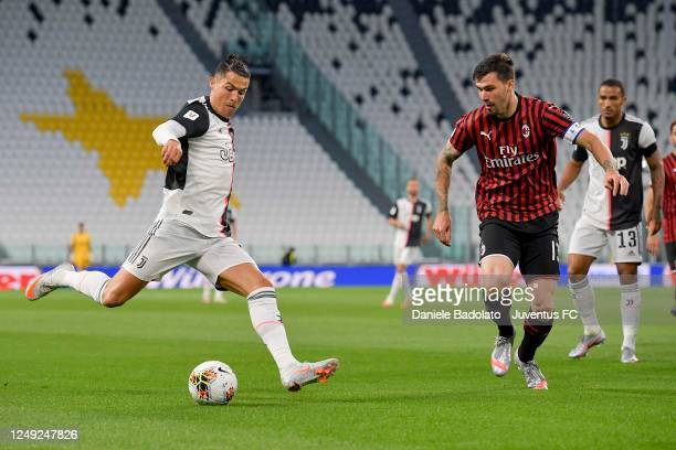 Cristiano Ronaldo of Juventus is challenged by Alessio Romagnoli of AC Milan during the Coppa Italia SemiFinal Second Leg match between Juventus and...