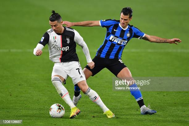 Cristiano Ronaldo of Juventus is challenged by Antonio Candreva of FC Internazionale during the Serie A match between Juventus and FC Internazionale...