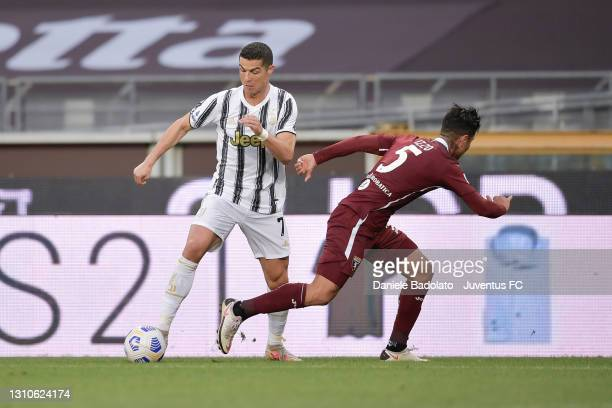 Cristiano Ronaldo of Juventus is challenged by Armando Izzo of Torino FC during the Serie A match between Torino FC and Juventus at Stadio Olimpico...