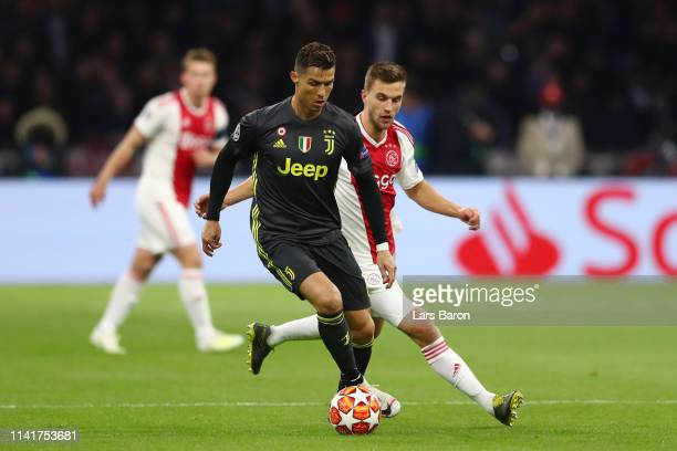 Cristiano Ronaldo of Juventus is challenged by Joel Veltman of Ajax during the UEFA Champions League Quarter Final first leg match between Ajax and...