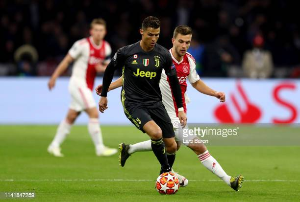 Cristiano Ronaldo of Juventus is challenged by Joel Veltman of Amsterdam during the UEFA Champions League Quarter Final first leg match between Ajax...