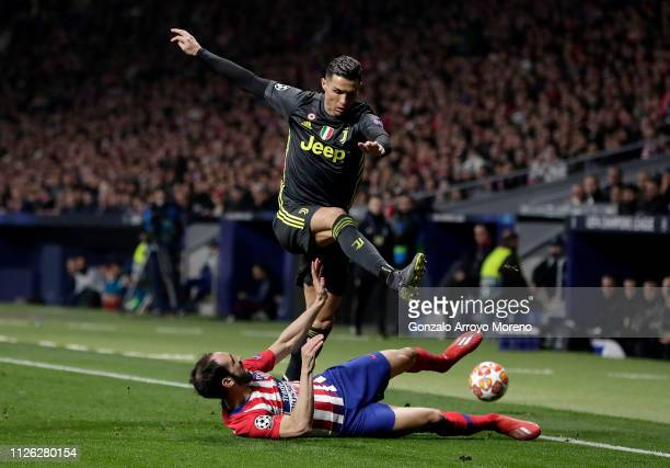 Cristiano Ronaldo of Juventus is challenged by Juanfran of Atletico Madrid during the UEFA Champions League Round of 16 First Leg match between Club...