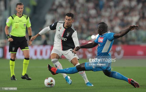 Cristiano Ronaldo of Juventus is challenged by Kalidou Koulibaly of SSC Napoli during the Serie A match between Juventus and SSC Napoli at Allianz...