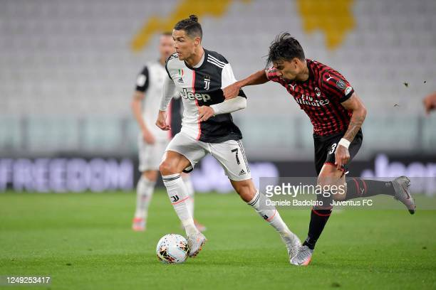 Cristiano Ronaldo of Juventus is challenged by Lucas Paqueta of AC Milan during the Coppa Italia Semi-Final Second Leg match between Juventus and AC...