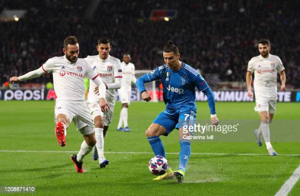 Cristiano Ronaldo of Juventus is challenged by Lucas Tousart of Olympique Lyon during the UEFA Champions League round of 16 first leg match between...
