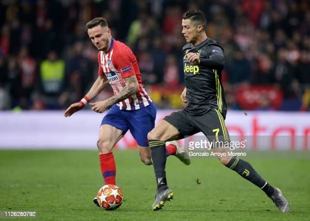 Cristiano Ronaldo of Juventus is challenged by Saul Niguez of Atletico Madrid during the UEFA Champions League Round of 16 First Leg match between...