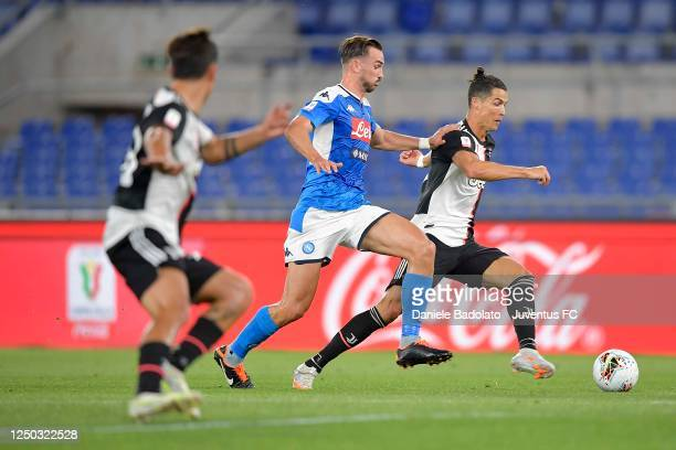 Cristiano Ronaldo of Juventus is tackled by Fabian Ruiz of SSC Napoli during the Coppa Italia Final match between Juventus and SSC Napoli at Olimpico...
