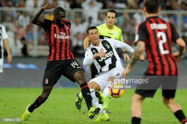 Cristiano Ronaldo of Juventus is tackled by Tiemoue Bakayoko of AC Milan during the Italian Supercup match between Juventus and AC Milan at King...