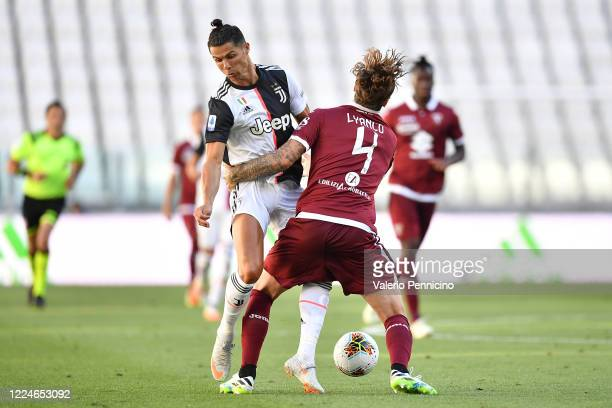 Cristiano Ronaldo of Juventus is tackled by Vojnovic Lyanco of Torino FC during the Serie A match between Juventus and Torino FC at Allianz Stadium...