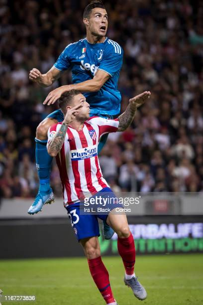 Cristiano Ronaldo of Juventus jumps above the head of Trippier of Atletico Madrid for the ball during the International Champions Cup Friendly match...