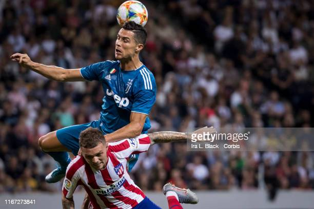 Cristiano Ronaldo of Juventus jumps and heads the ball above Trippier of Atletico Madrid for the ball during the International Champions Cup Friendly...