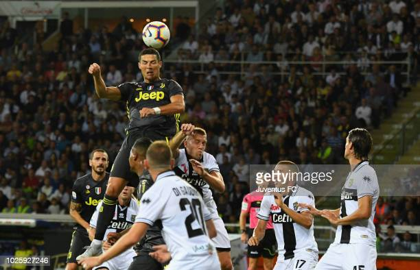 Cristiano Ronaldo of Juventus jumps for a header during the serie A match between Parma Calcio and Juventus at Stadio Ennio Tardini on September 1...