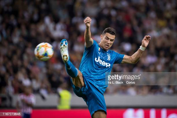 Cristiano Ronaldo of Juventus jumps up and kicks the ball during the International Champions Cup Friendly match between Atletico de Madrid and...