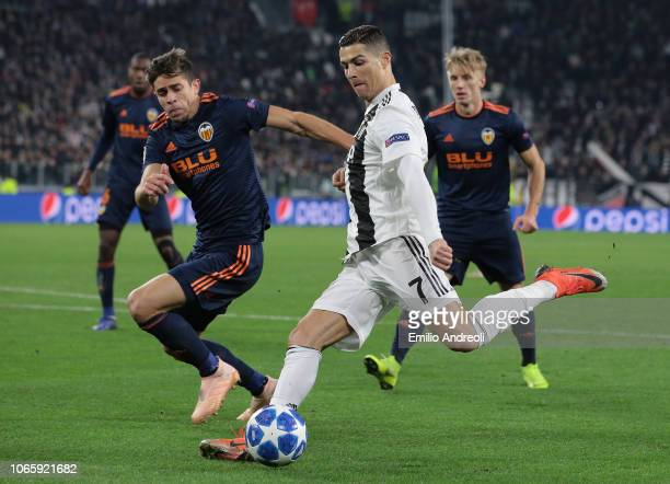 Cristiano Ronaldo of Juventus kicks the ball and makes the assist for a goal of his teammate Mario Mandzukic during the Group H match of the UEFA...