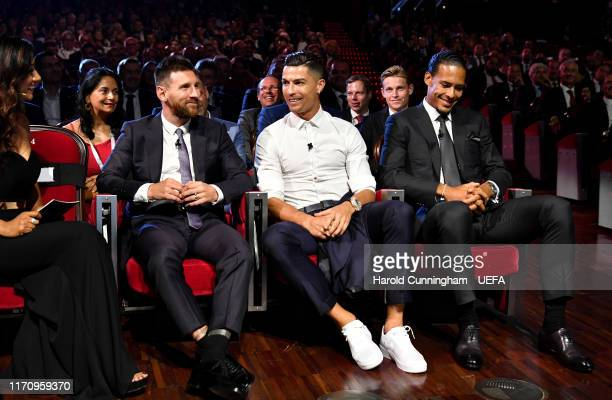 Cristiano Ronaldo of Juventus Lionel Messi of FC Barcelona and Virgil Van Dijk of Liverpool react during the UEFA Champions League Draw part of the...