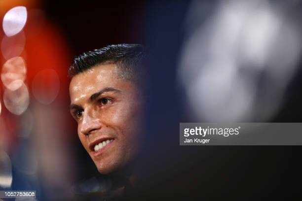 Cristiano Ronaldo of Juventus looks on during a press conference ahead of their UEFA Champions League Group H match against Manchester United at Old...