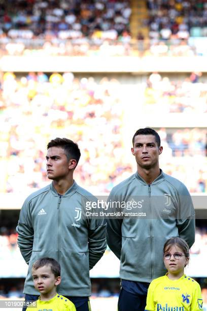 Cristiano Ronaldo of Juventus looks on next to teammate Paulo Dybala ahead of the Serie A match between Chievo Verona and Juventus at Stadio...