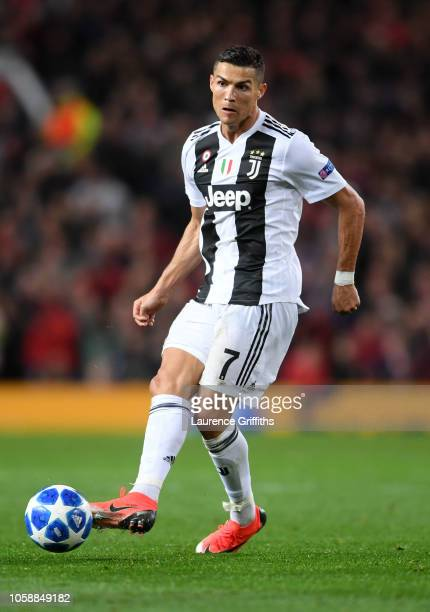Cristiano Ronaldo of Juventus passes the ball during the Group H match of the UEFA Champions League between Manchester United and Juventus at Old...