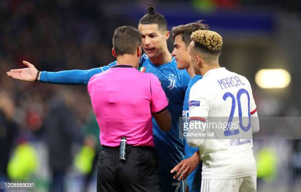 Cristiano Ronaldo of Juventus, Paulo Dybala of Juventus and Fernando Marcel of Olympique Lyon confronts referee Jesus Gil Manzano during the UEFA...