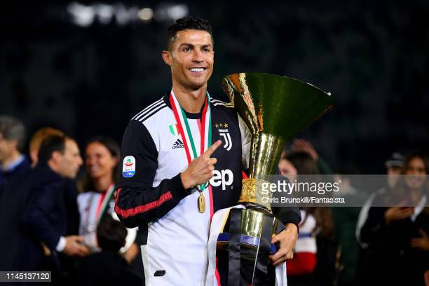 Cristiano Ronaldo of Juventus poses with the Serie A trophy following the Serie A match between Juventus and Atalanta BC at Allianz Stadium on May 19...