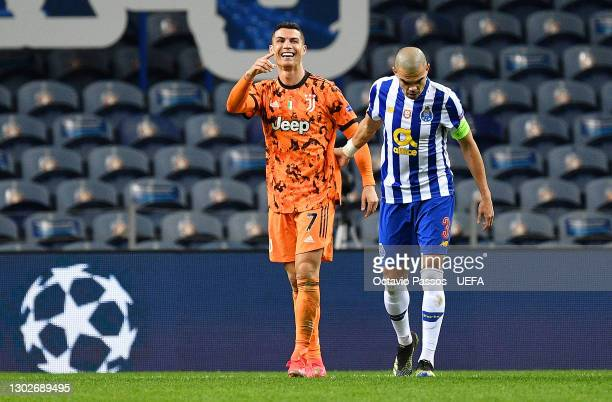 Cristiano Ronaldo of Juventus reacts as he interacts with Pepe of FC Porto following the UEFA Champions League Round of 16 match between FC Porto and...