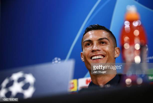 Cristiano Ronaldo of Juventus reacts during a press conference ahead of their UEFA Champions League Group H match against Manchester United at Old...