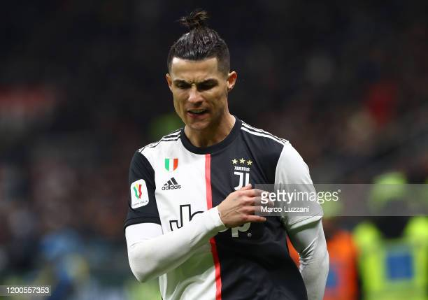 Cristiano Ronaldo of Juventus reacts during the Coppa Italia Semi Final match between AC Milan and Juventus at Stadio Giuseppe Meazza on February 13...