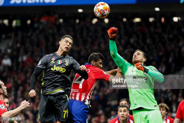 Cristiano Ronaldo of Juventus Rodri of Atletico Madrid Jan Oblak of Atletico Madrid during the UEFA Champions League match between Atletico Madrid v...