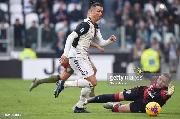 Cristiano Ronaldo of Juventus rounds Robin Olsen of Cagliari during the Serie A match between Juventus and Cagliari Calcio at Allianz Stadium on...