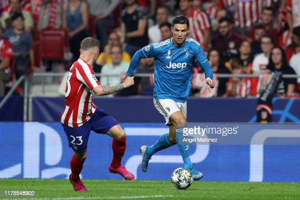 Cristiano Ronaldo of Juventus runs at Kieran Trippier of Atletico Madrid during the UEFA Champions League group D match between Atletico Madrid and...