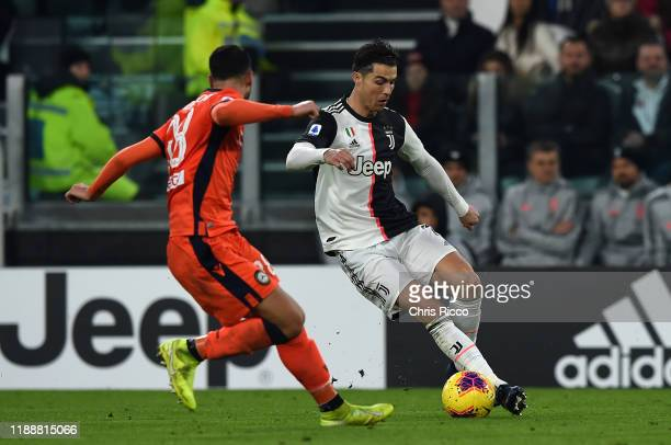 Cristiano Ronaldo of Juventus runs at Rolando Mandragora of Udinese during the Serie A match between Juventus and Udinese Calcio at Allianz Stadium...