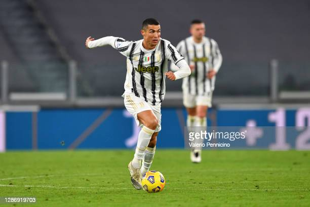 Cristiano Ronaldo of Juventus runs with the ball during the Serie A match between Juventus and Cagliari Calcio at on November 21, 2020 in Turin,...