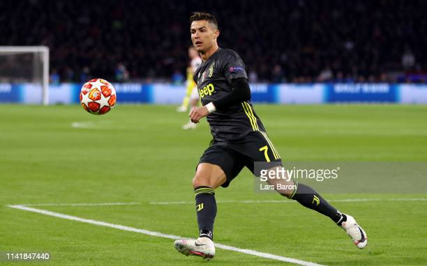 Cristiano Ronaldo of Juventus runs with the ball during the UEFA Champions League Quarter Final first leg match between Ajax and Juventus at Johan...