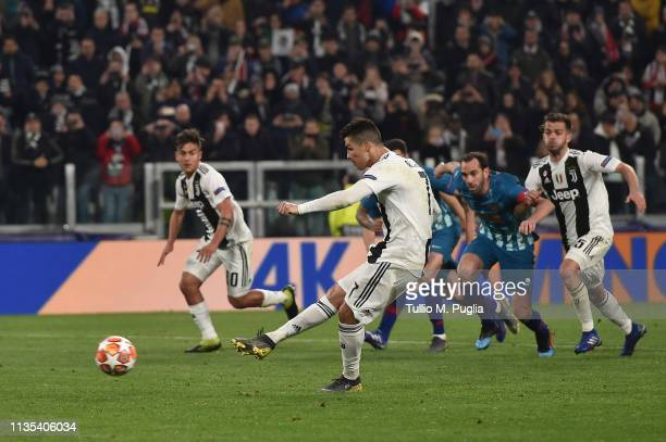 Cristiano Ronaldo of Juventus scores a penalty during the UEFA Champions League Round of 16 Second Leg match between Juventus and Club de Atletico...