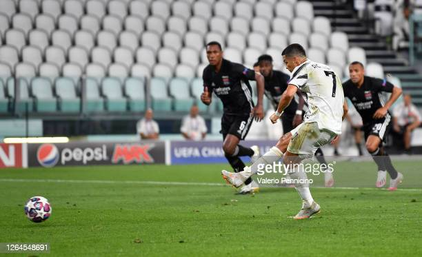 Cristiano Ronaldo of Juventus scores a penalty for his team's first goal during the UEFA Champions League round of 16 second leg match between...