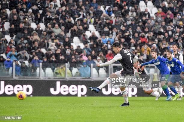 Cristiano Ronaldo of Juventus scores a penalty kick during the Serie A match between Juventus and US Sassuolo on December 1 2019 in Turin Italy