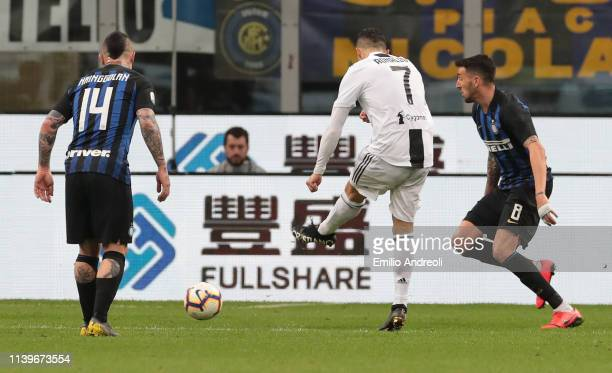 Cristiano Ronaldo of Juventus scores his goal during the Serie A match between FC Internazionale and Juventus at Stadio Giuseppe Meazza on April 27...
