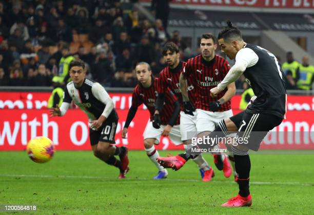 Cristiano Ronaldo of Juventus scores his goal from the penalty spot during the Coppa Italia Semi Final match between AC Milan and Juventus at Stadio...
