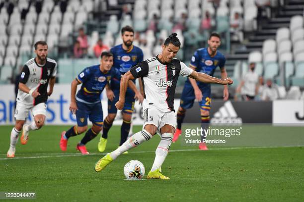 Cristiano Ronaldo of Juventus scores his goal from the penalty spot during the Serie A match between Juventus and US Lecce at Allianz Stadium on June...
