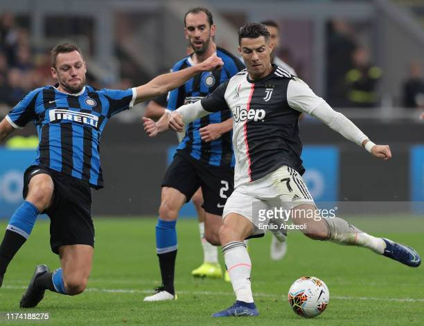 Cristiano Ronaldo of Juventus scores his goal that will be disallowed during the Serie A match between FC Internazionale and Juventus at Stadio...