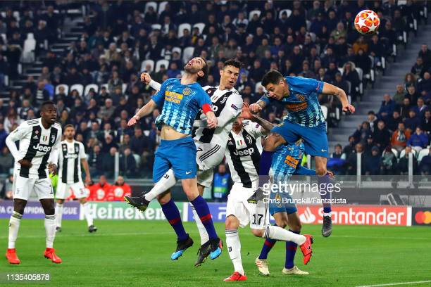 Cristiano Ronaldo of Juventus scores his side's second goal during the UEFA Champions League Round of 16 Second Leg match between Juventus and Club...