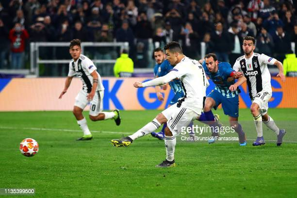 Cristiano Ronaldo of Juventus scores his side's third goal from the penalty spot during the UEFA Champions League Round of 16 Second Leg match...