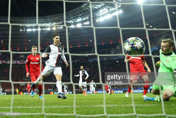 Cristiano Ronaldo of Juventus scores his team's first goal during the UEFA Champions League group D match between Bayer Leverkusen and Juventus at...