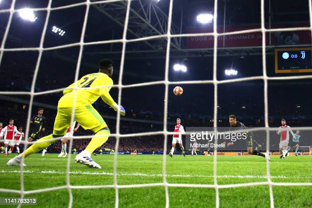 Cristiano Ronaldo of Juventus scores his team's first goal past Andre Onana of Ajax during the UEFA Champions League Quarter Final first leg match...