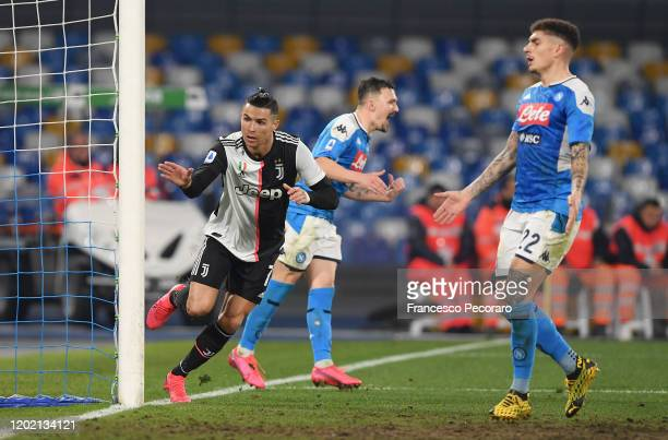 Cristiano Ronaldo of Juventus scores the 21 goal as Mario Rui and Giovanni Di Lorenzo of SSC Napoli react during the Serie A match between SSC Napoli...