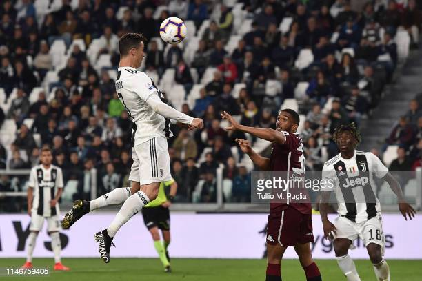 Cristiano Ronaldo of Juventus scores the equalizing goal during the Serie A match between Juventus and Torino FC on May 03, 2019 in Turin, Italy.