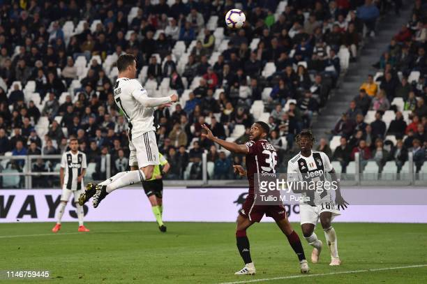 Cristiano Ronaldo of Juventus scores the equalizing goal during the Serie A match between Juventus and Torino FC on May 03 2019 in Turin Italy