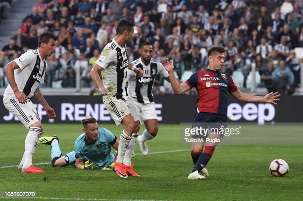 Cristiano Ronaldo of Juventus scores the opening goal during the Serie A match between Juventus and Genoa CFC at Allianz Stadium on October 20 2018...