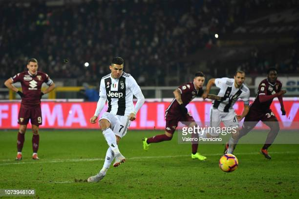 Cristiano Ronaldo of Juventus scores the opening goal from the penalty spot during the Serie A match between Torino FC and Juventus at Stadio...